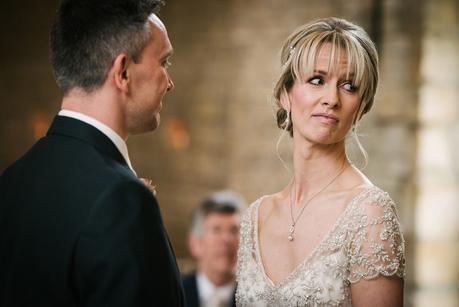 bride looking at registrar