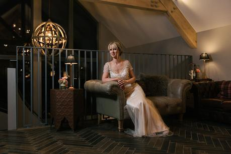 bride sitting on a sofa with off camera flash