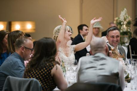 bride with her hands in the air