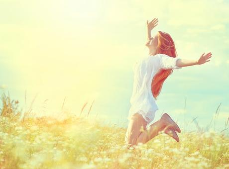 jumping woman in field