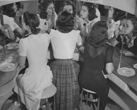 1940s-Fashion-Forecast---models-make-up-at-dressing-table