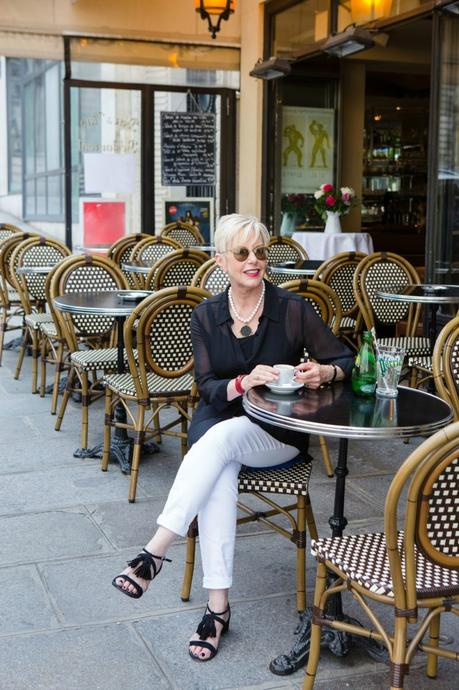 style blogger Susan B of une femme d'un certain age takes a break at a sidewalk cafe in Paris