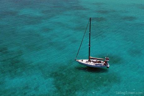 sailboat in clear blue water