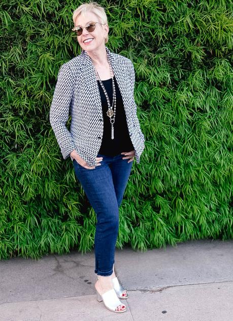 style blogger Susan B. of une femme d'un certain âge wearing a Missoni knit jacket with jeans and metallic sandals