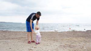 daddy on the beach with daughter