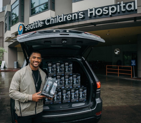 Christian Athlete Russell Wilson Deliver Father's Day Gifts To Seattle Children's Hospital