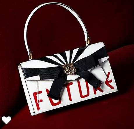 Gucci Handbag in blak, white and red.