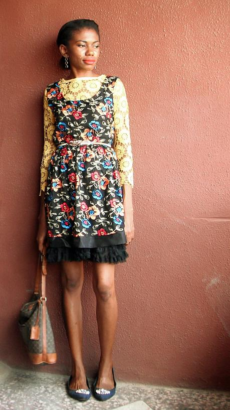 yellow lace top layered underneath lace dress