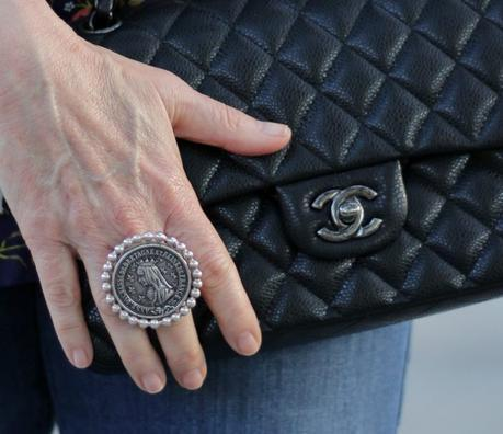 details: style blogger Susan B. wearing French Kande silver ring with vintage French medallion and Chanel classic flap bag