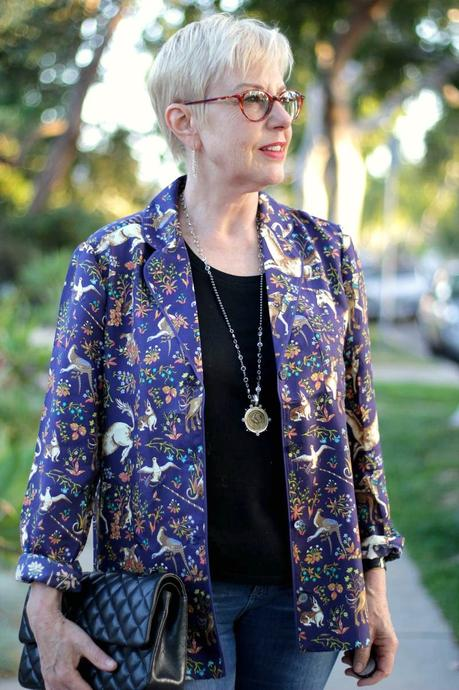 details: Susan B. of une femme d'un certain age wears a J.Crew silk pajama top as a jacket, with a Chanel bag and French Kande jewelry