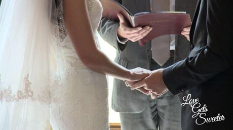 bride and groom holding hands during their wedding ceremony at armathwaite hall caught on the wedding video