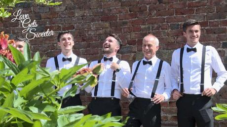 the boys laughing in their braces and bow ties for the wedding photographer