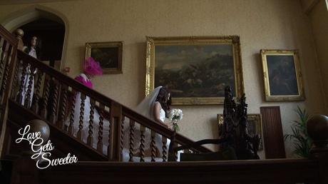 Bride and her Mum making their way down the old staircase at Armthawaite Hall for the wedding videographer