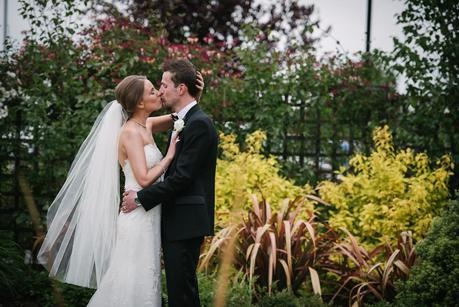 bride and groom kissing outside mythe barn