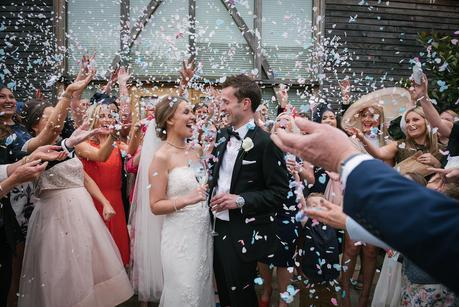confetti being thrown at mythe barn