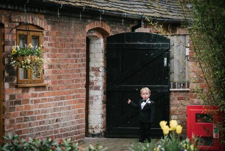 little boy pointing at a door