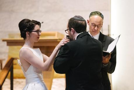 groom drinking from a metal cup at jewish wedding
