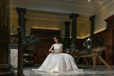 bride sitting down and looking at the floor