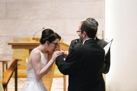 bride drinking from a metal cup