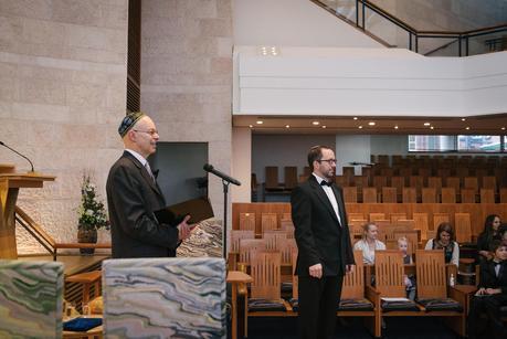 groom watching bride walk in