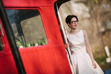 Bride on red bus