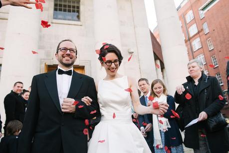 bride and groom having confetti thrown