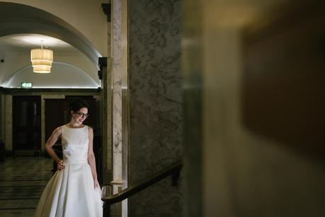 bride posing at the town hall