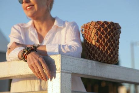 details: Hermes leather wrap bracelet and French Kande bracelet worn by style bloger Susan B. of une femme d'un certain age