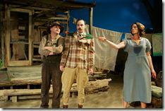 from right, Josie Hogan (Carolyn Klein) whips T. Stedman Harder (Stuart Ritter) into shape with a little help from Dad (Brad Armacost) in Seanachaí Theatre Company's production of A MOON FOR THE MISBEGOTTEN by Eugene O'Neill, directed by Kevin Theis at The Irish American Heritage Center.