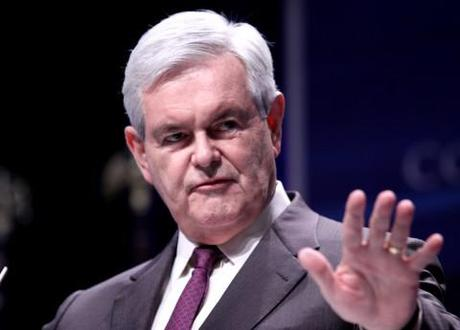 Newt Gingrich slashes campaign staff but insists he won't drop out of the Republican nomination race