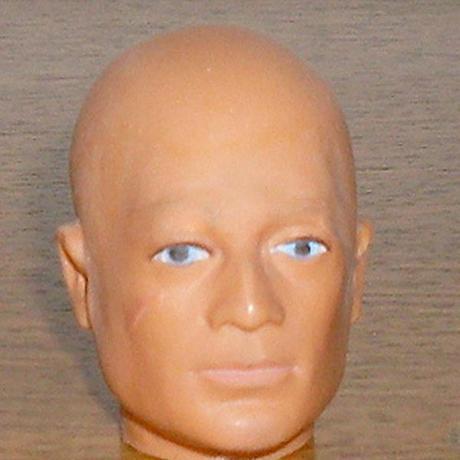 bald G.I. Joe Cancer awareness doll
