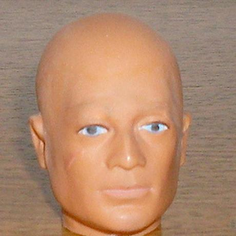 bald G.I. Joe Cancer awareness doll