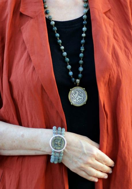 Detail: style blogger Susan B. of une femme d'un certain age wears stone bead jewelry with vintage French medallions.