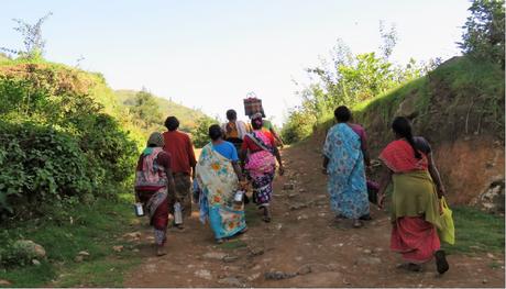 Village folk trudging to work