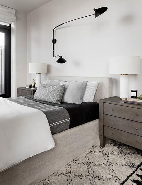 Two-arm wall lamp in the bedroom. Bedroom photo by Rikki Snyder