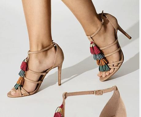 Caged sandals available at Saks Fifth Avenue under 4500INR . Taseel details on camel color base make them classy and chic.