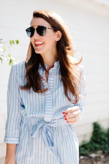 Amy Havins wears a blue and white romper.