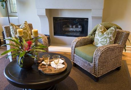 two wicker arm chairs in living room