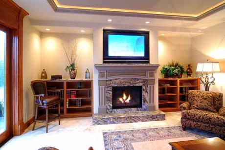 The fireplace is set in stone and is nicely decorated
