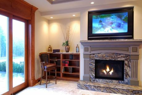 granite clad fireplace in living room