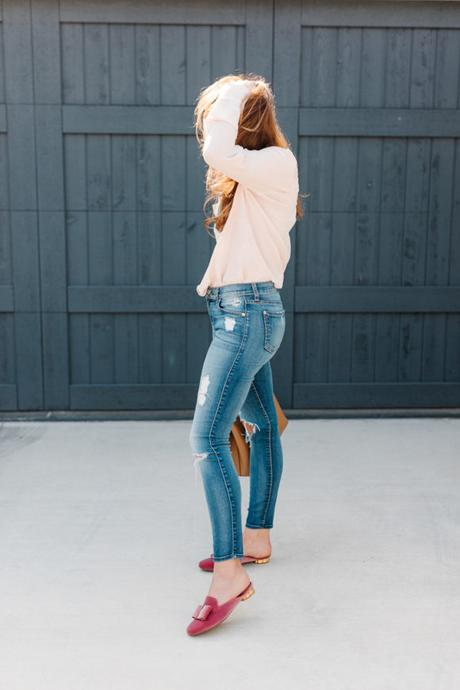 Amy Havins wears a blush blouse, ripped jeans and velvet flats.
