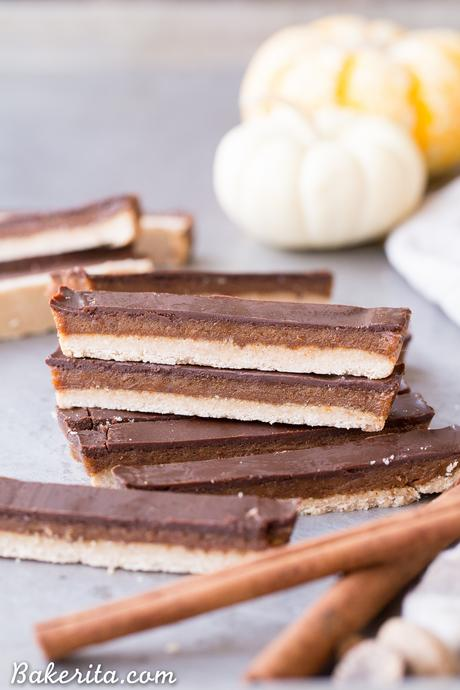 These Pumpkin Spice Twix Bars are a warm, pumpkin-spiced twist on a classic candy favorite! These copycat homemade Twix Bars are gluten-free, paleo, and vegan, and the bold pumpkin spice flavors take them out of this world.