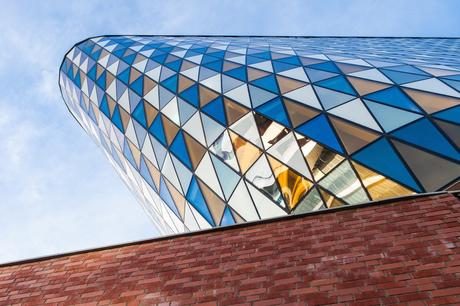 62. Aula Medica, an auditorium complex at Sweden's Karolinska Institute, is an imposing, leaning tower with multi-coloured, triangle panels echoing its flat-iron shape.