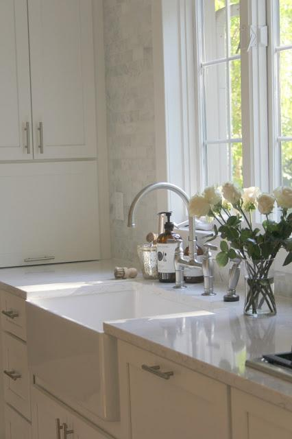 Modern farmhouse white kitchen with farm sink and Shaker cabinets by Hello Lovely Studio