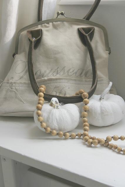 White painted pumpkins and vintage bag by Hello Lovely Studio