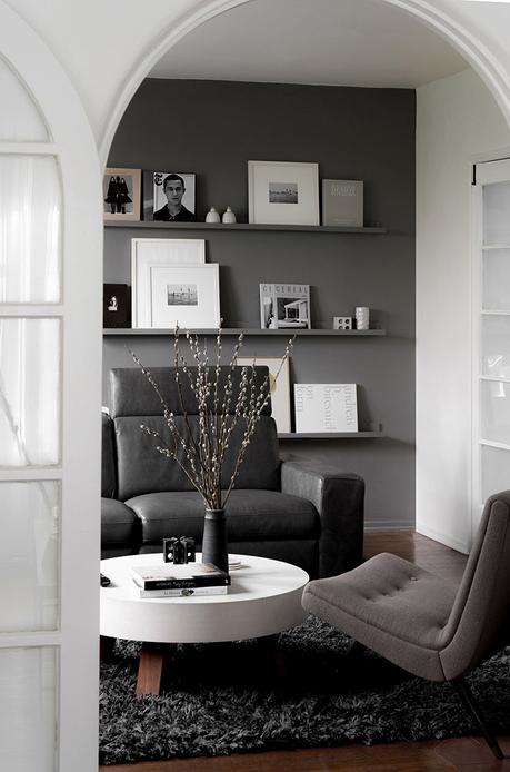Dark gray living room with display shelves