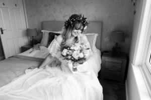 Villa farm wedding photography bride with flower crown sits in window light