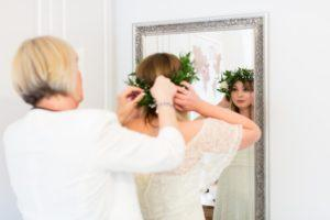 Villa farm wedding photography bride with flower crown looks in mirror