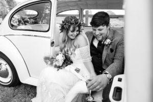Villa farm wedding photography bride and groom in vintage VW beetle