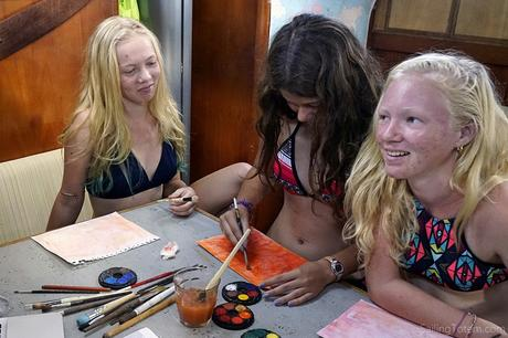 girls work on Thanksgiving crafts